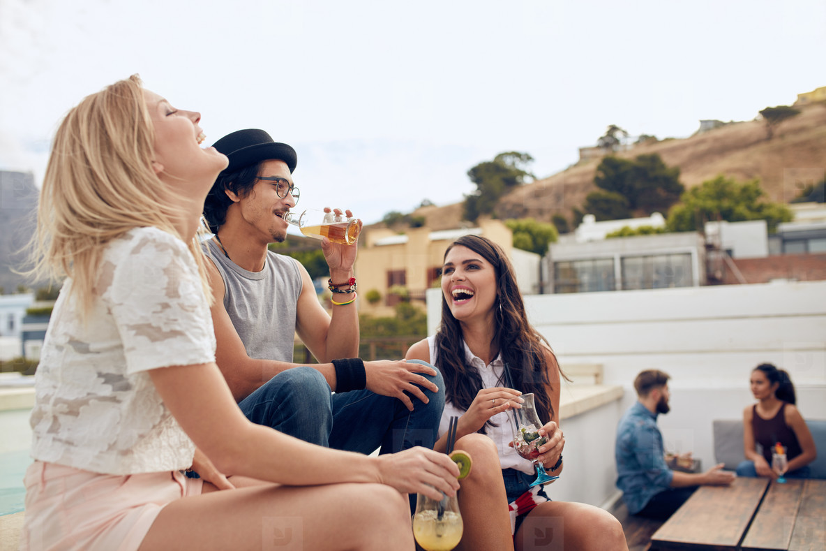 Young people enjoying at rooftop party
