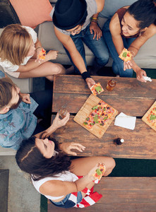 Friends having drinks and pizza at party
