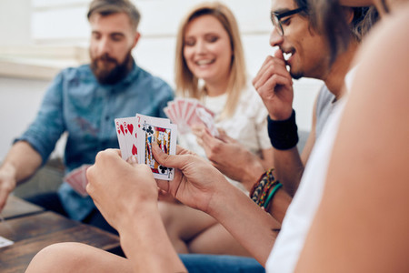 Group of friends playing card