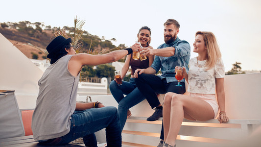 Group of friends enjoying drinks party