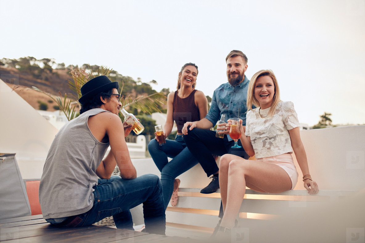 Young people having drinks at party