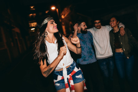 Young woman enjoying in a party with friends