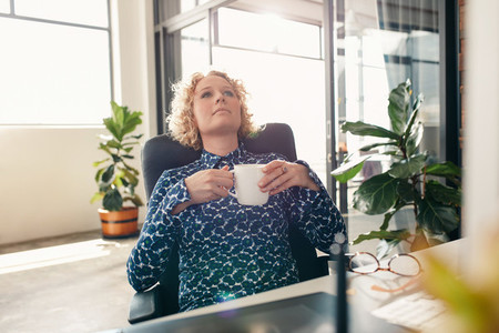 Thoughtful businesswoman at desk in office