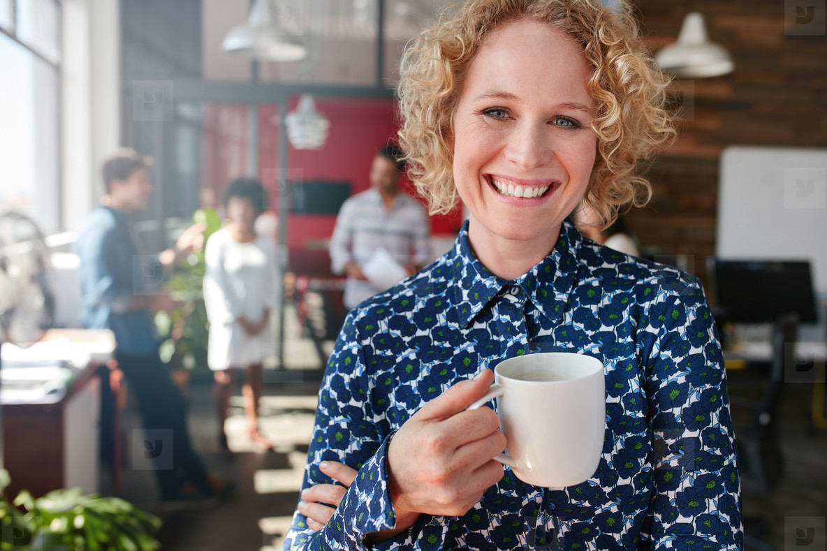 Female creative professional having a coffee in office