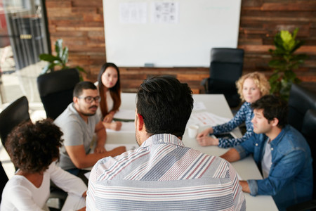Man explaining business plan to coworkers