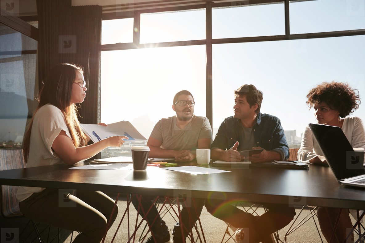 Woman consulting new business plans with her colleagues