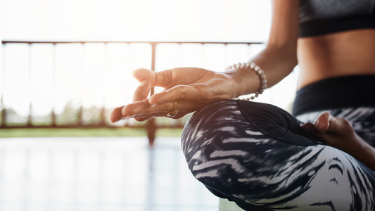 Woman meditating in the lotus position