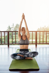 Healthy woman meditating at yoga class