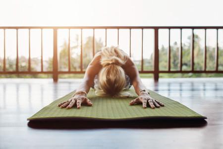 Fitness female performing yoga
