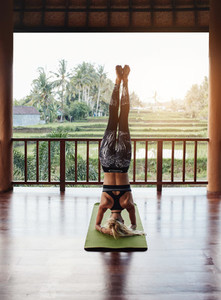 Woman doing headstand yoga pose