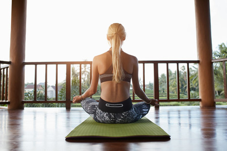 Woman meditating in lotus position