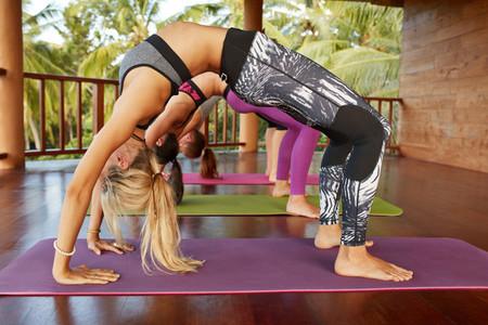 Young people doing Chakrasana yoga