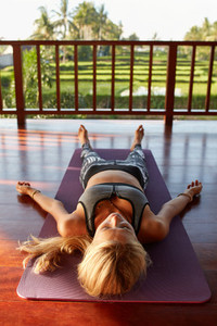 Fitness female relaxing in the Corpse pose