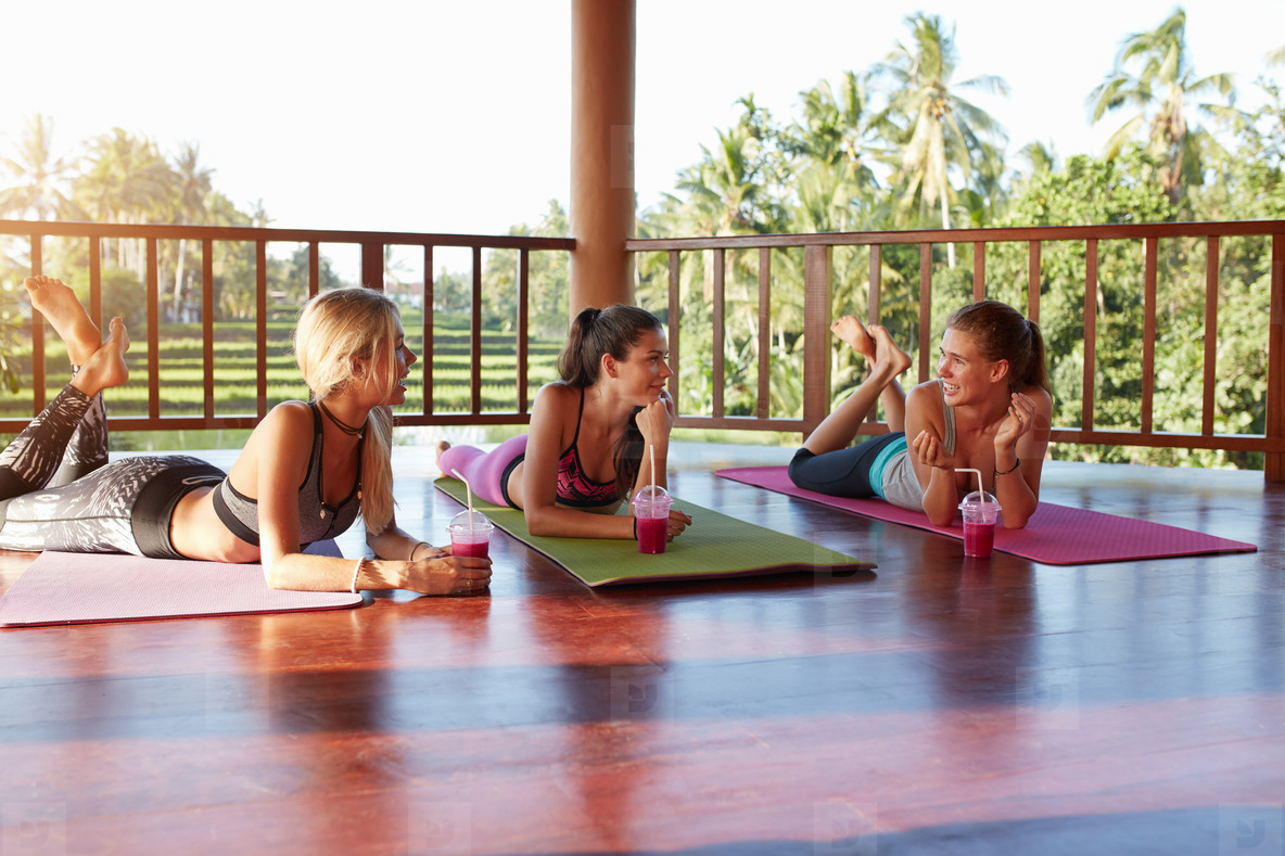 Young women chatting after yoga class