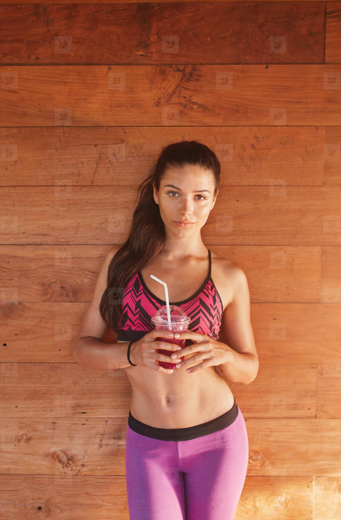 Sporty woman with glass of fresh fruit juice