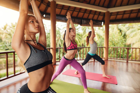 Three young woman doing yoga at class