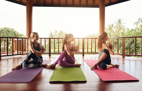 Healthy young women practicing yoga