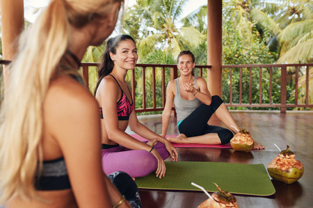 Group of women relaxing after yoga class