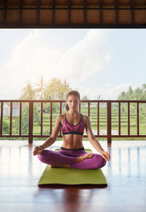 Young woman practicing yoga at health center