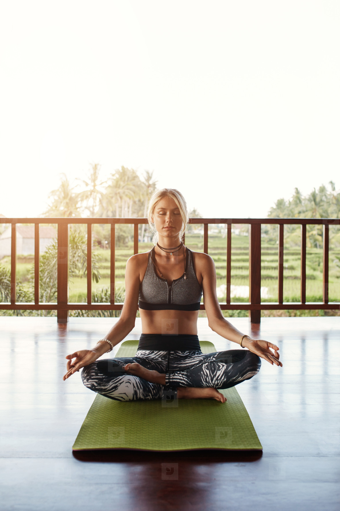 Fit young female meditating in yoga class