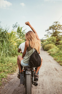 Young couple enjoying motorbike ride