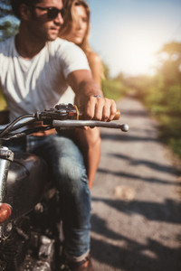Man riding on a motorcycle with girlfriend