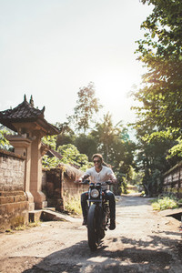Young couple out on a motorbike ride
