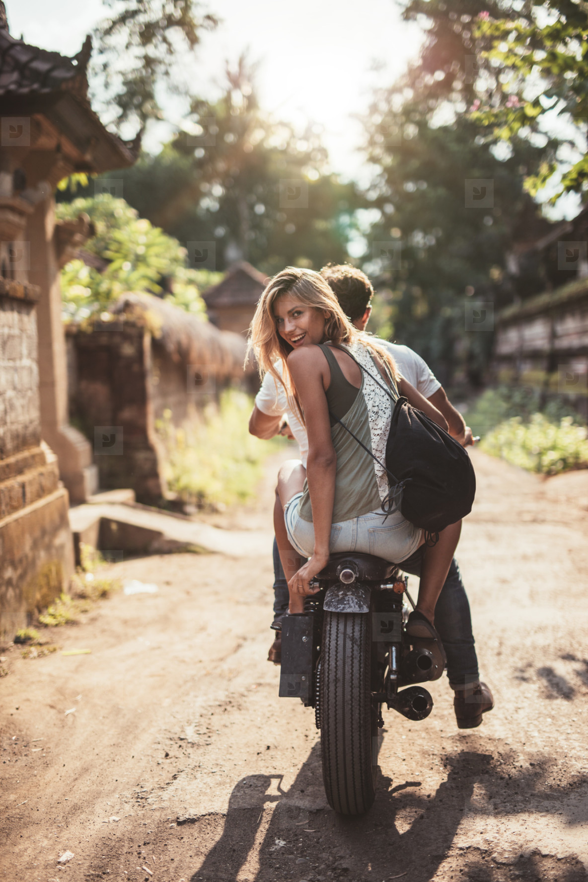 Young couple riding motorcycle