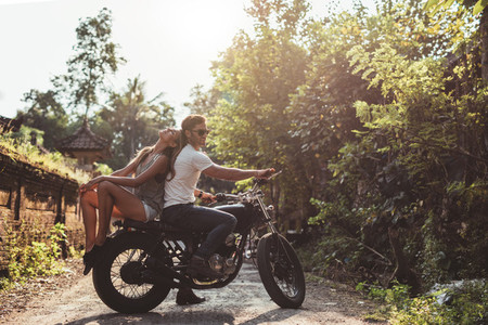 Young couple sitting out on a motorcycle