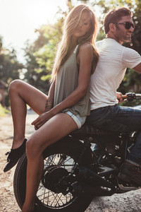 Couple outdoors on motorbike