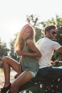 Young couple having fun on a motorcycle