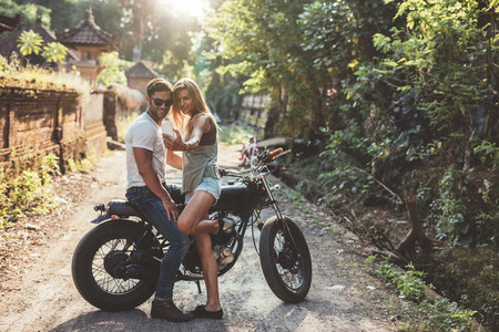 Loving young couple taking a selfie with motorcycle