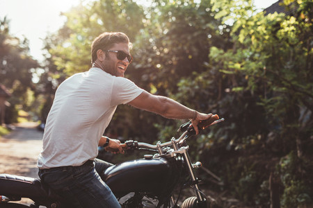 Handsome young man on motorcycle