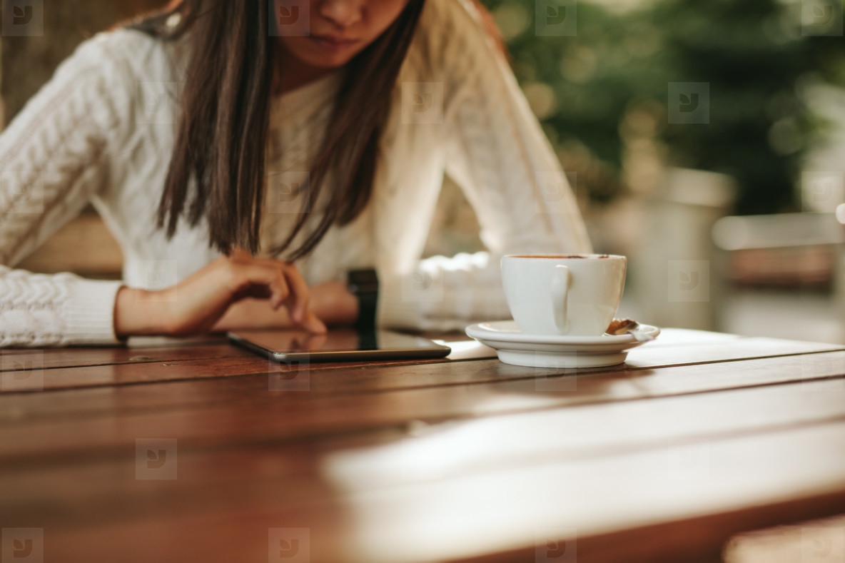 Woman using with tablet at cafe