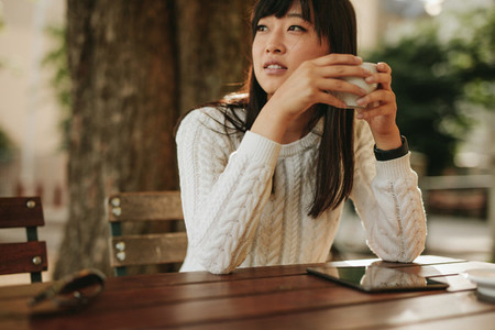 Attractive young woman at outdoor cafe