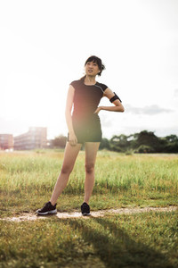 Woman runner in park ready for morning exercise
