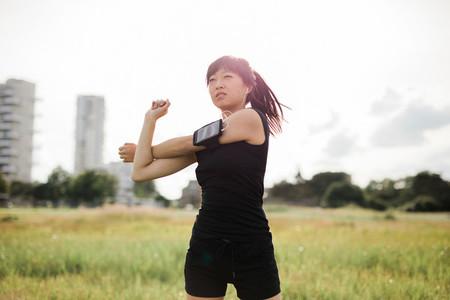Woman stretching at urban park