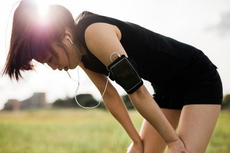 Sportswoman taking break from running workout