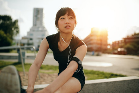 Female runner doing stretching workout