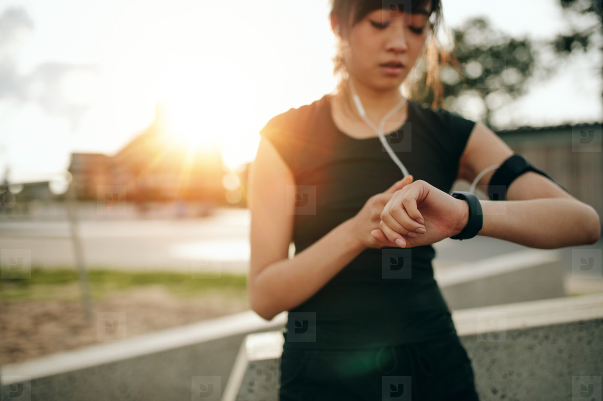 Fitness female checking her performance on smartwatch