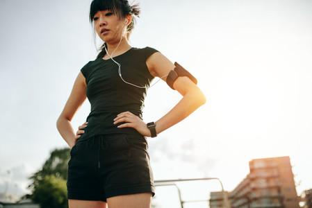 Female runner taking a break outdoors