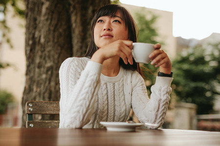 Chinese female having coffee at cafe