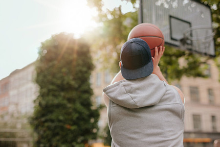 Young guy playing basketball