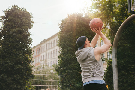 Streetball player playing on outdoor court