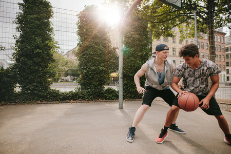 Young men playing a game of basketball