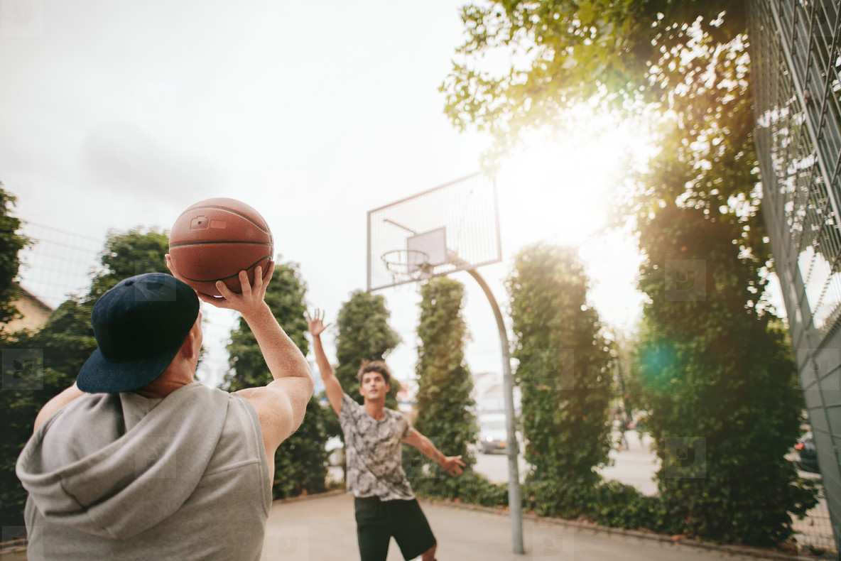 Streetball players on court playing basketball