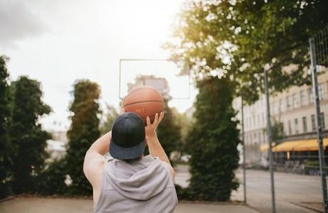Streetball player shoots basket