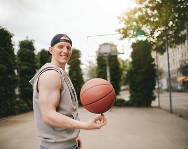 Teenage streetball player spinning the ball