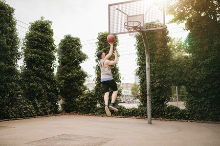 Teenage guy playing streetball