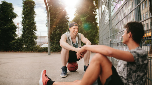 Streetball players taking rest after playing a game